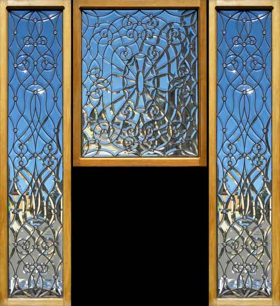 Intricate beveled door panel and two matching sidelights for 15 panel beveled glass door